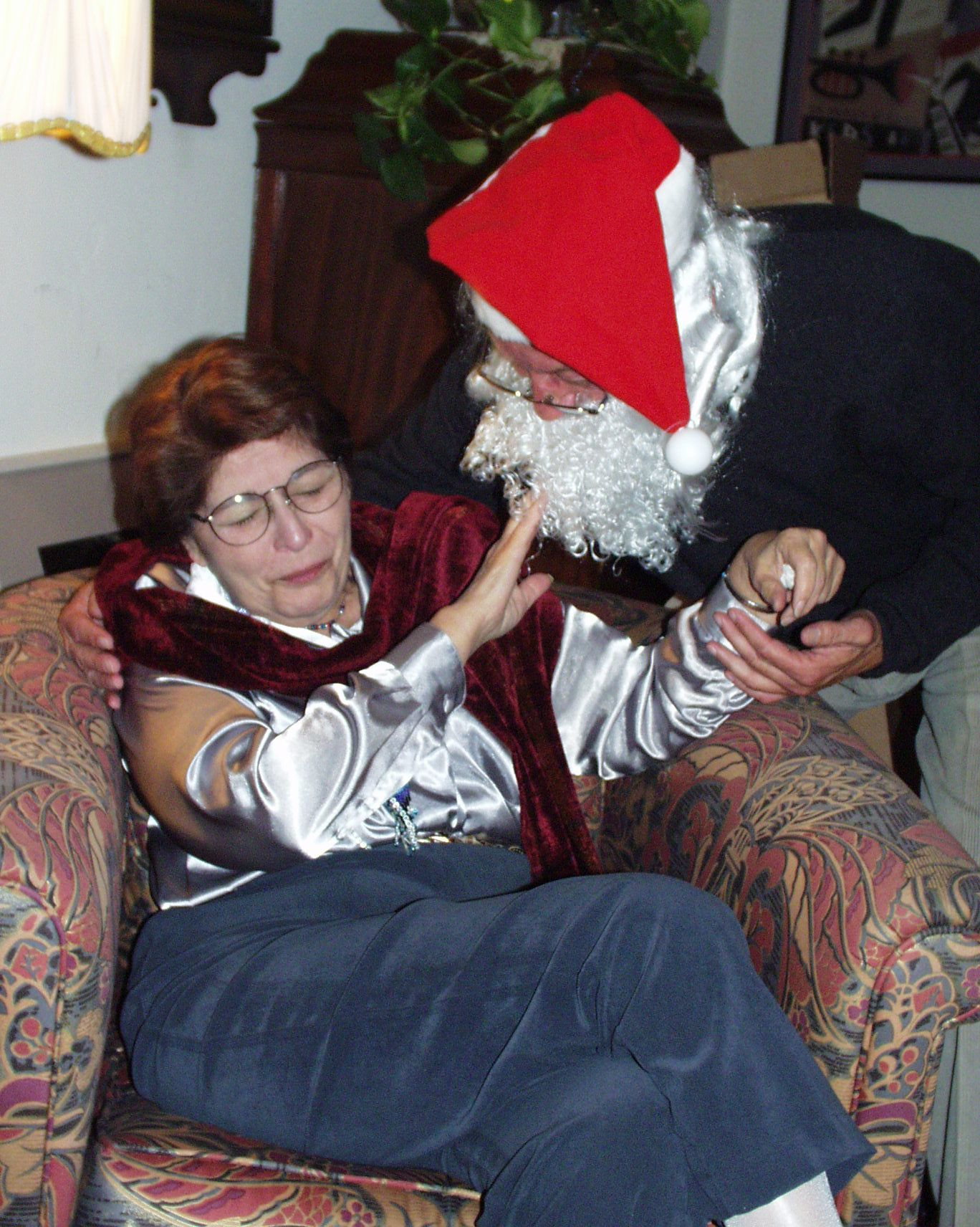 Lois is fending off Santa Dick, 2000 (Photo credit: San Diego video producer Patty Mooney of Crystal Pyramid Productions)