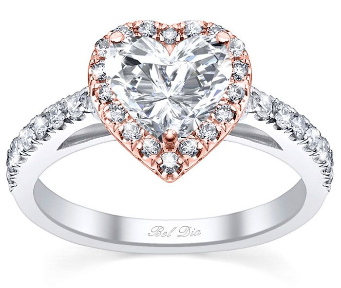 Heart shaped rose gold engagement ring with diamond halo ring