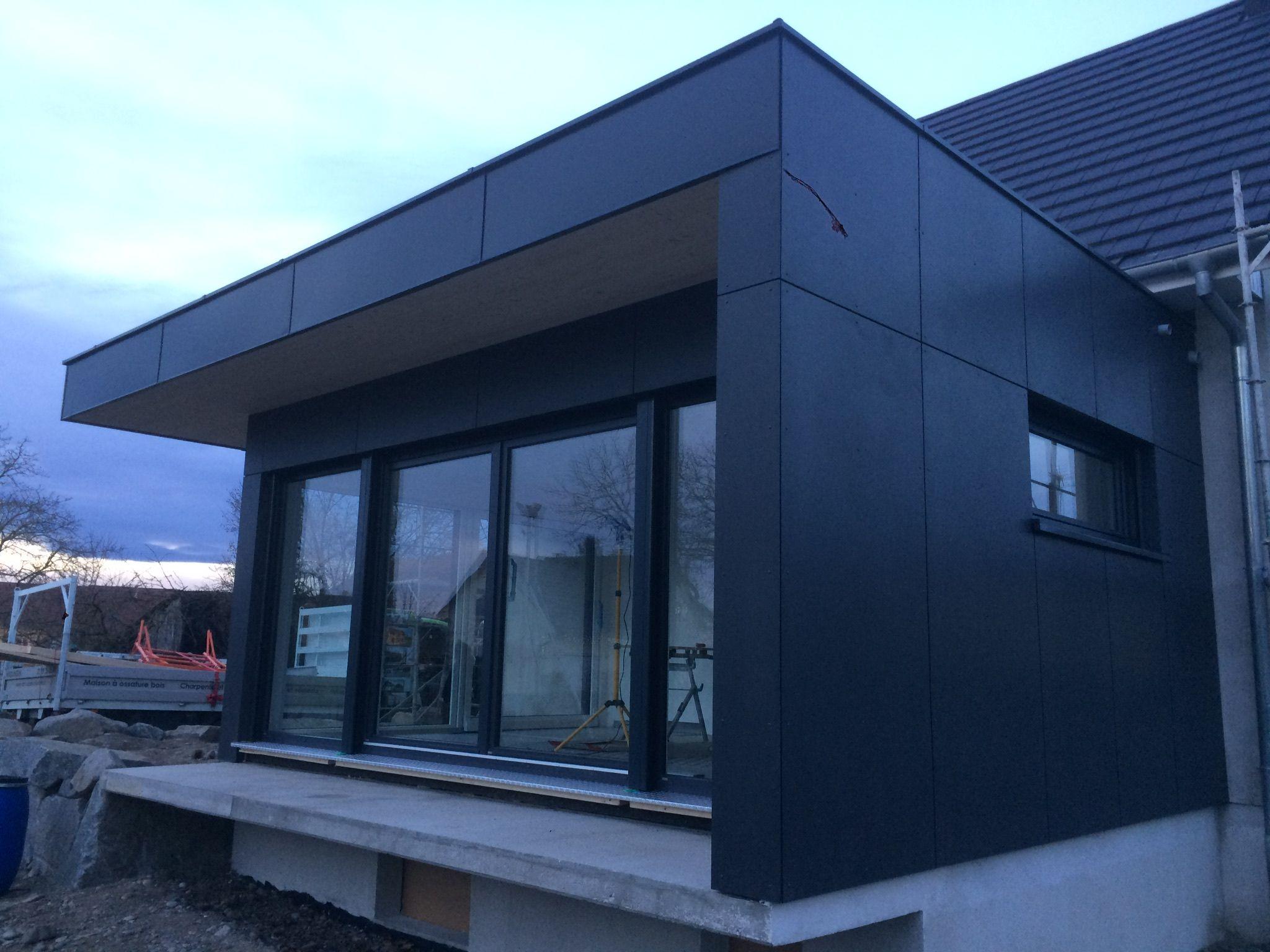 Extension ossature bois  toit plat dans le Haut Rhin avec bardage
