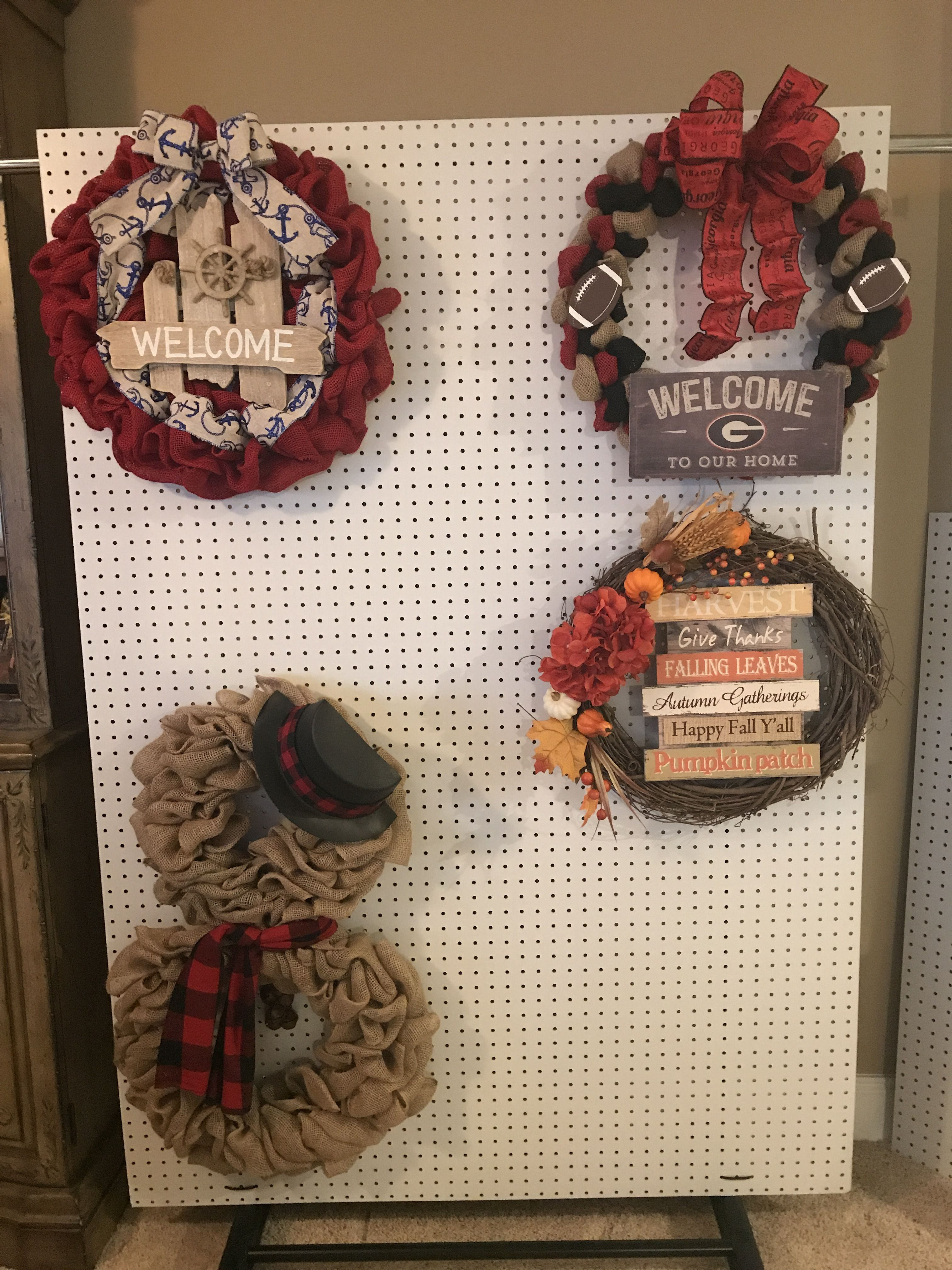 Craft show display made with a sheet of peg board zip tied to a