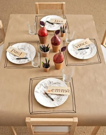 I love this idea for a kid's table! Just some plain brown wrapping paper, a couple of pots, a couple of pears and drawn placemats (with cups of crayons)!      I see this as being very easy to switch up for different holidays with color and decor in the little pots!    borrowed from Mark Lipinski's Fan Page on FB.