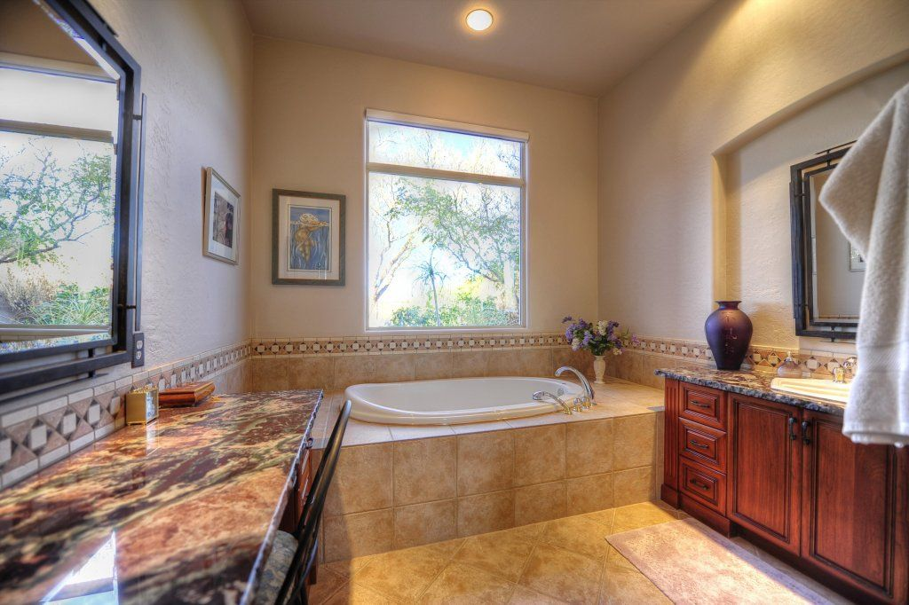 This DC Ranch master bath features a Jacuzzi tub ...