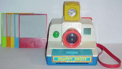 Toy Polaroid Camera. The front removed so you could wetten a sponge that would transfer to the pictures revealing the photograph.