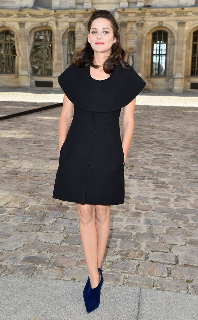 Marion Cotillard makes a gorgeous statement in this unique LBD and bright blue ankle booties.