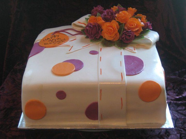Gift cake with simple bow and gumpaste flowers