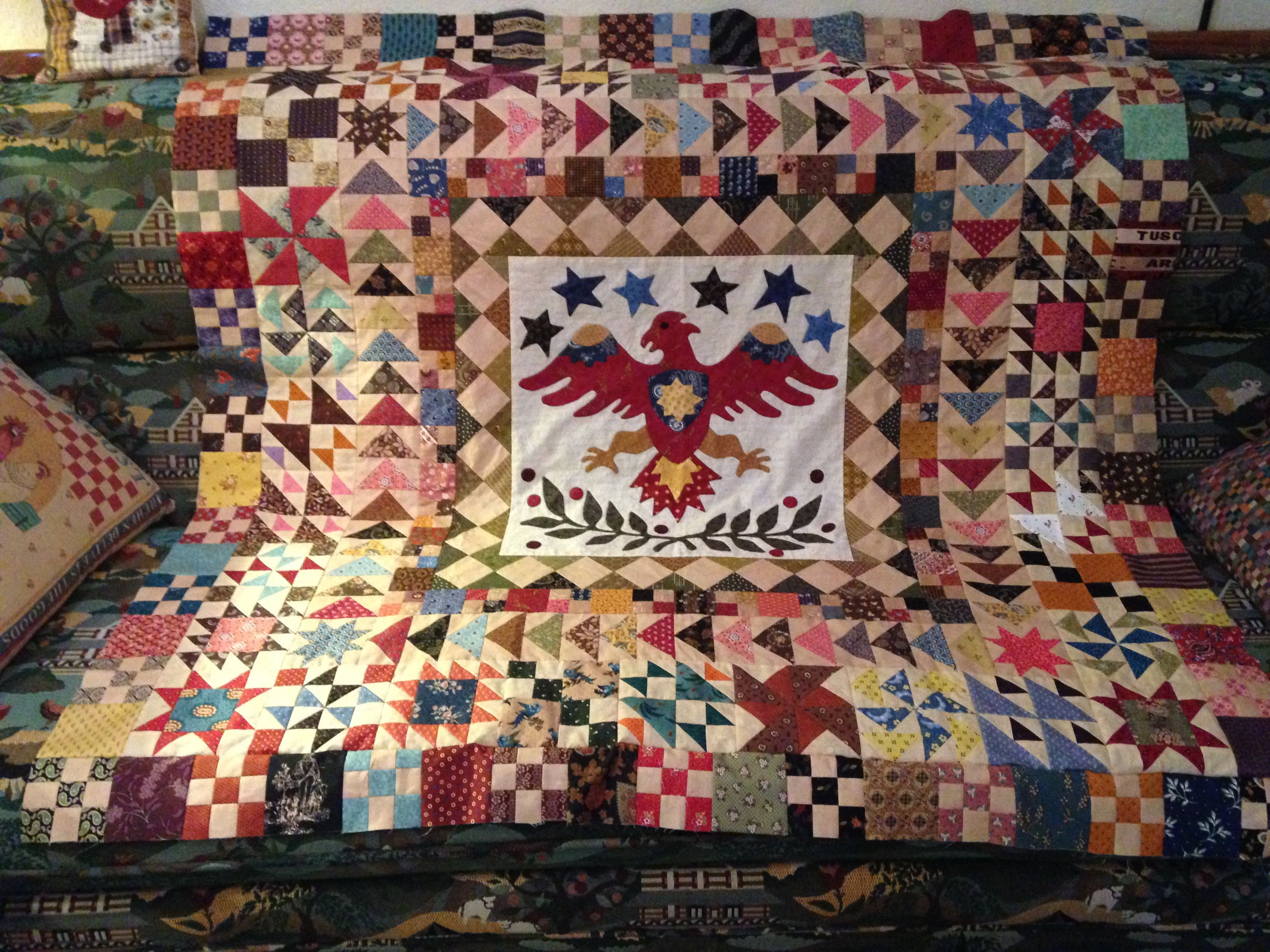 A work in progress ... Mainly used Civil War reproduction fabrics. Only one more row of pieced squares to go and then I can finish it!  That should only take another three years!