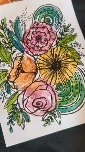 Photo of Floral ink doodles on watercolor