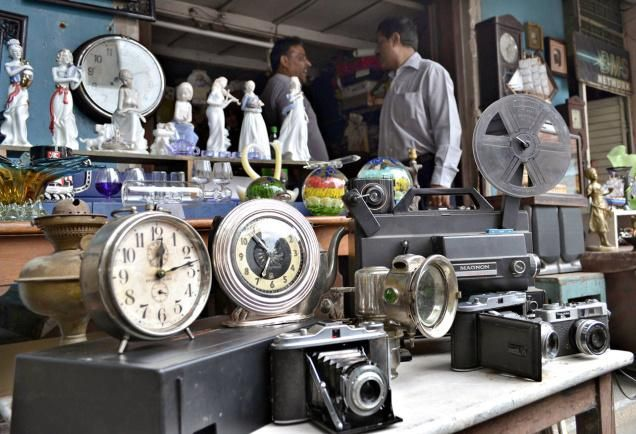 Value in junk: Mahaveer Chand's inconspicuous antique store on Berlie  Street has old clocks, antique furniture and even cycle lamps, strewn  across the floor ... - Value In Junk: Mahaveer Chand's Inconspicuous Antique Store On