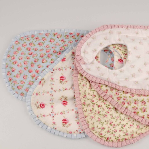 Adorable chintz floral baby bibs by Miss Rose Sister Violet. Each with a different floral pattern and a contrast fabric pleated border. Velcro closure   Hand made in Australia Le Petite Putti
