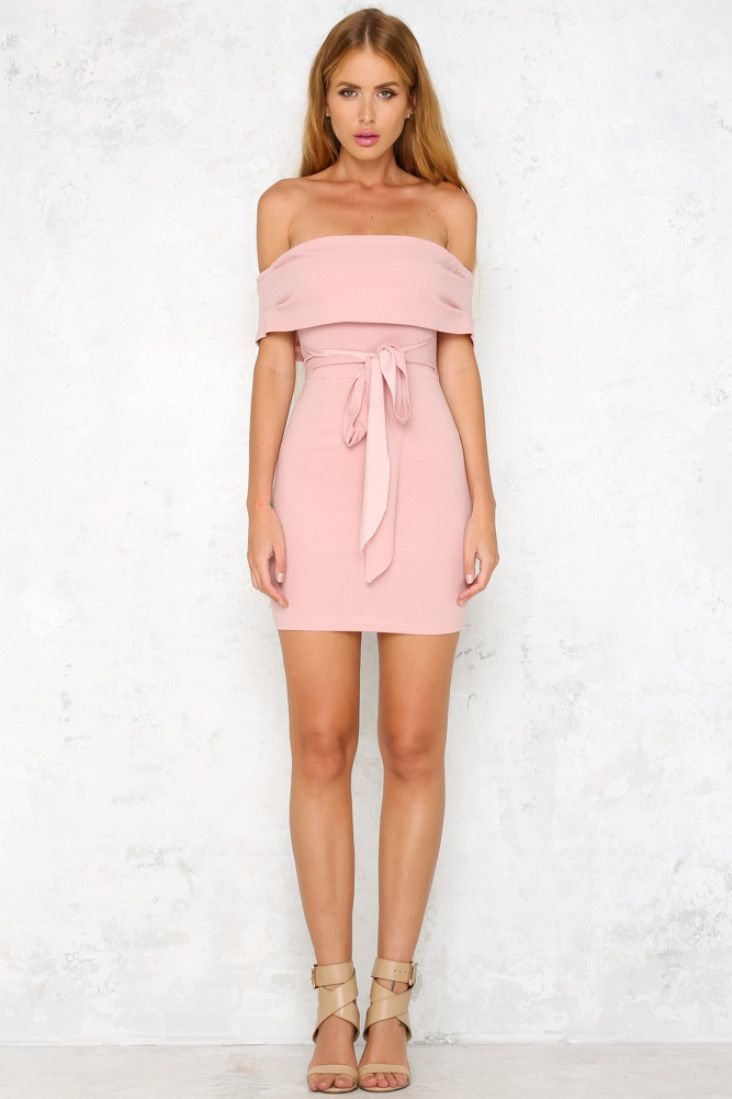 The sealed with a kiss dress has an off the shoulder neckline on a