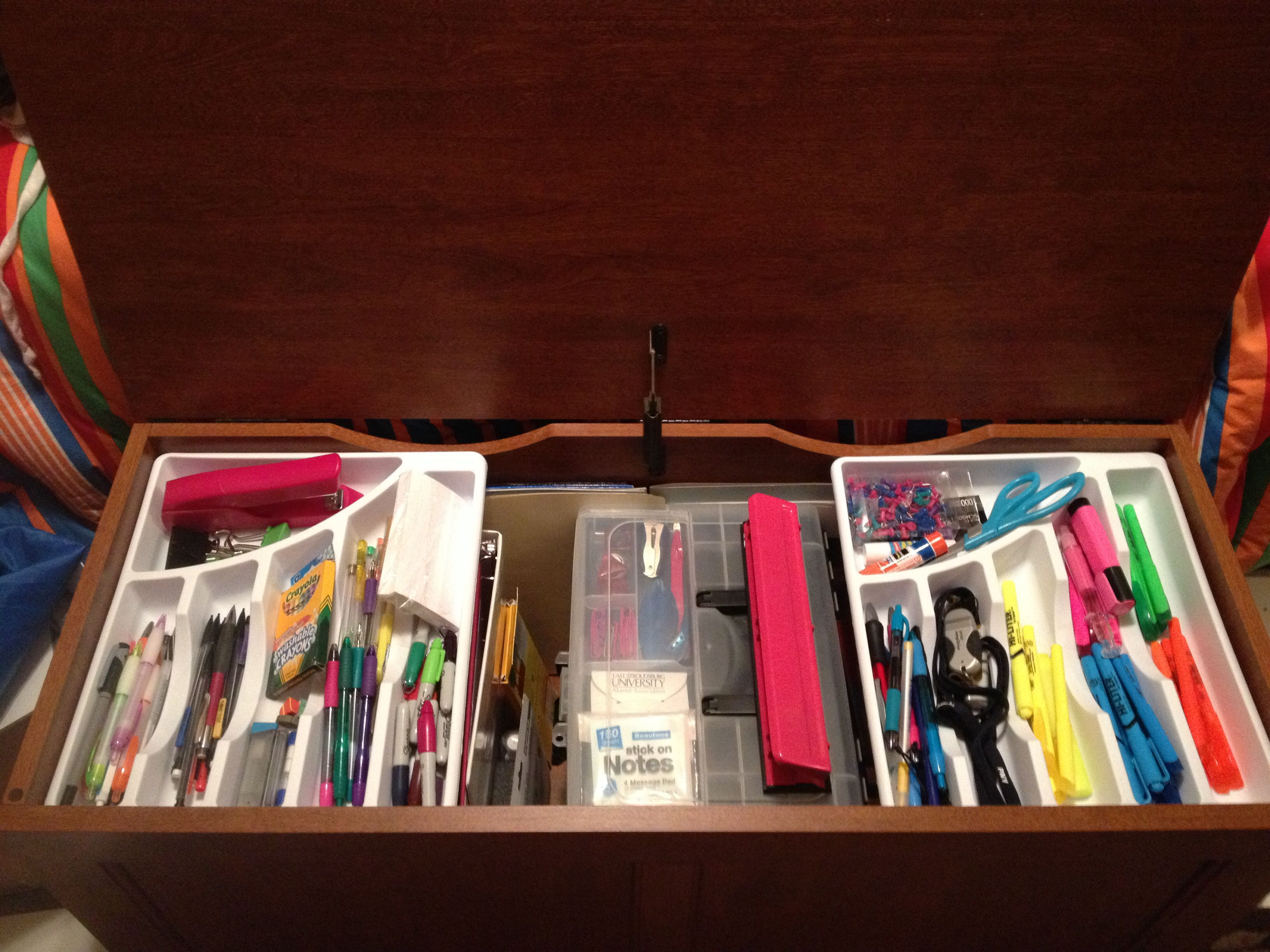 My desk doesn t have drawers so I used cutlery organizers cheap at Walmart for pens pencils etc on top