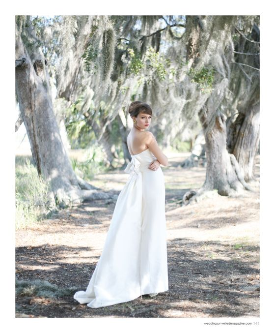 Wedding dress by Carolina Herrera, earrings from House of Lavande. From the Spring 2012 issue of Weddings Unveiled Magazine. Photographed on location at Boone Hall Plantation. www.weddingsunveiledmagazine.com