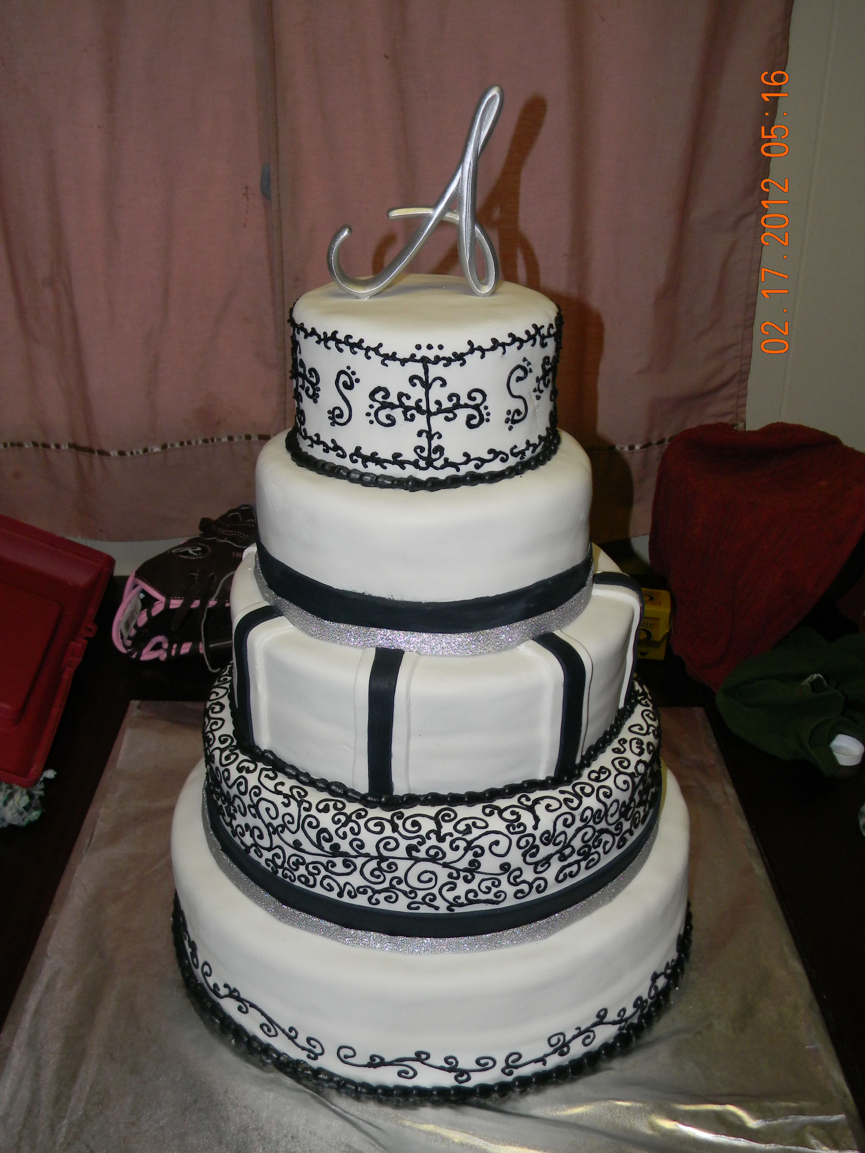 Winter wedding cake. Color scheme, black,white,silver ...