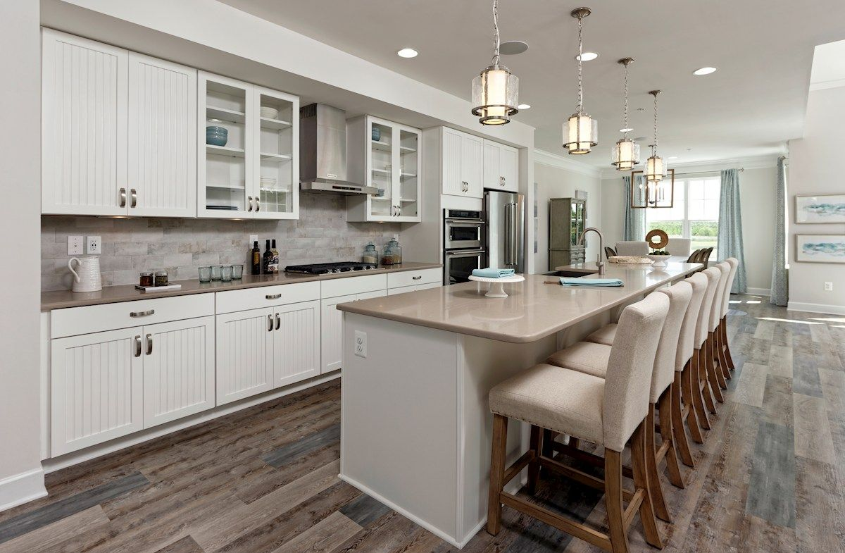 The Coastal Chic Open Layout Kitchen In The Fenwick Model Home At Bayside Fenwick Island Open Kitchen Layouts Kitchen Inspirations Home