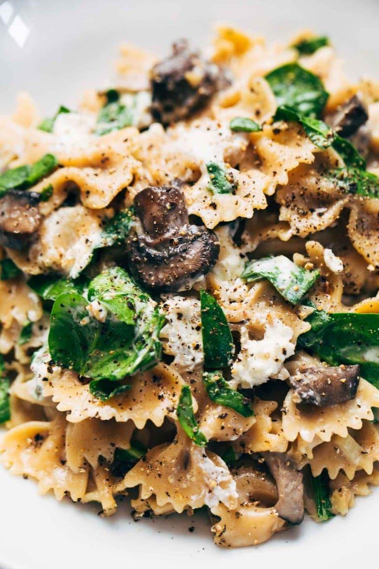 Date Night Mushroom Pasta with Goat Cheese - swimming in a white wine, garlic, and cream sauce. Perfect for a date night in! #pasta #vegetarian #dinner #recipe #pasta | pinchofyum.com