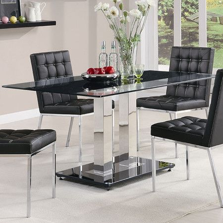 Add sleek contemporary flair to your dining room with this glass and