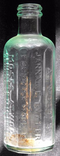 "Rare Atwood's Jannaice Bitters blue/green glass bottle.  Bottle reads Atwood's ""Jaunnaice Bitters Formerly Atwood Georgetown, Mass"".  Approximately 6 inches tal"