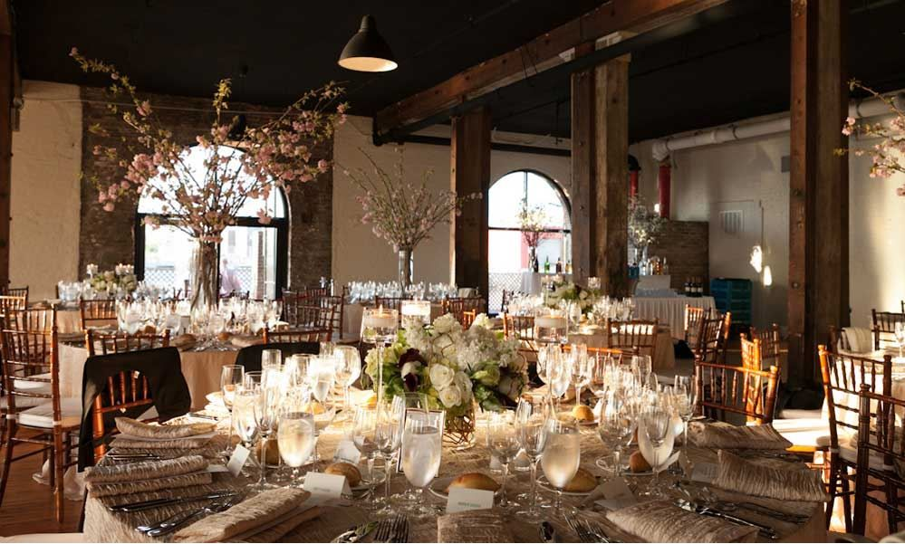 the liberty warehouse interior is stunning on its own add simple and elegant floral arrangements