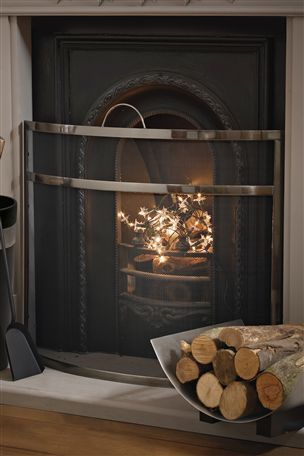 fire guard and fairylights in the fireplace child friendly cosy