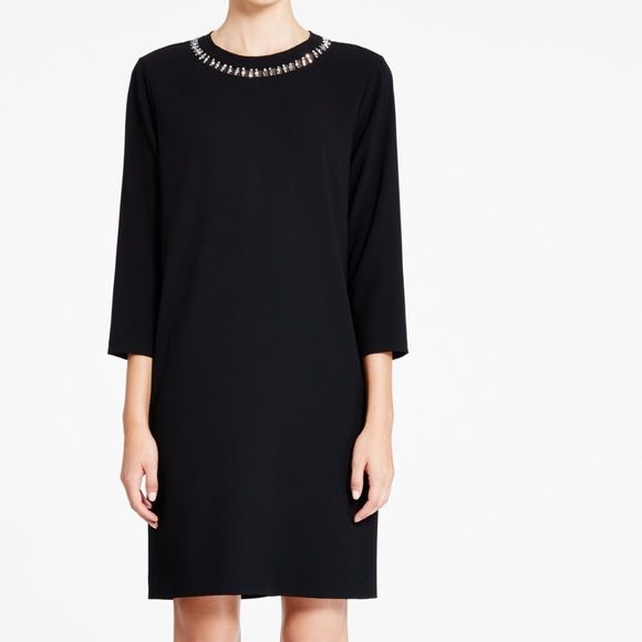 DKNY embellished neck dress The embellished neckline on this 3/4 sleeve dress will have you turning heads wherever you go. Made from satin back crepe, this dress is an LBD to own this season. Hem and cuffs have come out DKNY Dresses