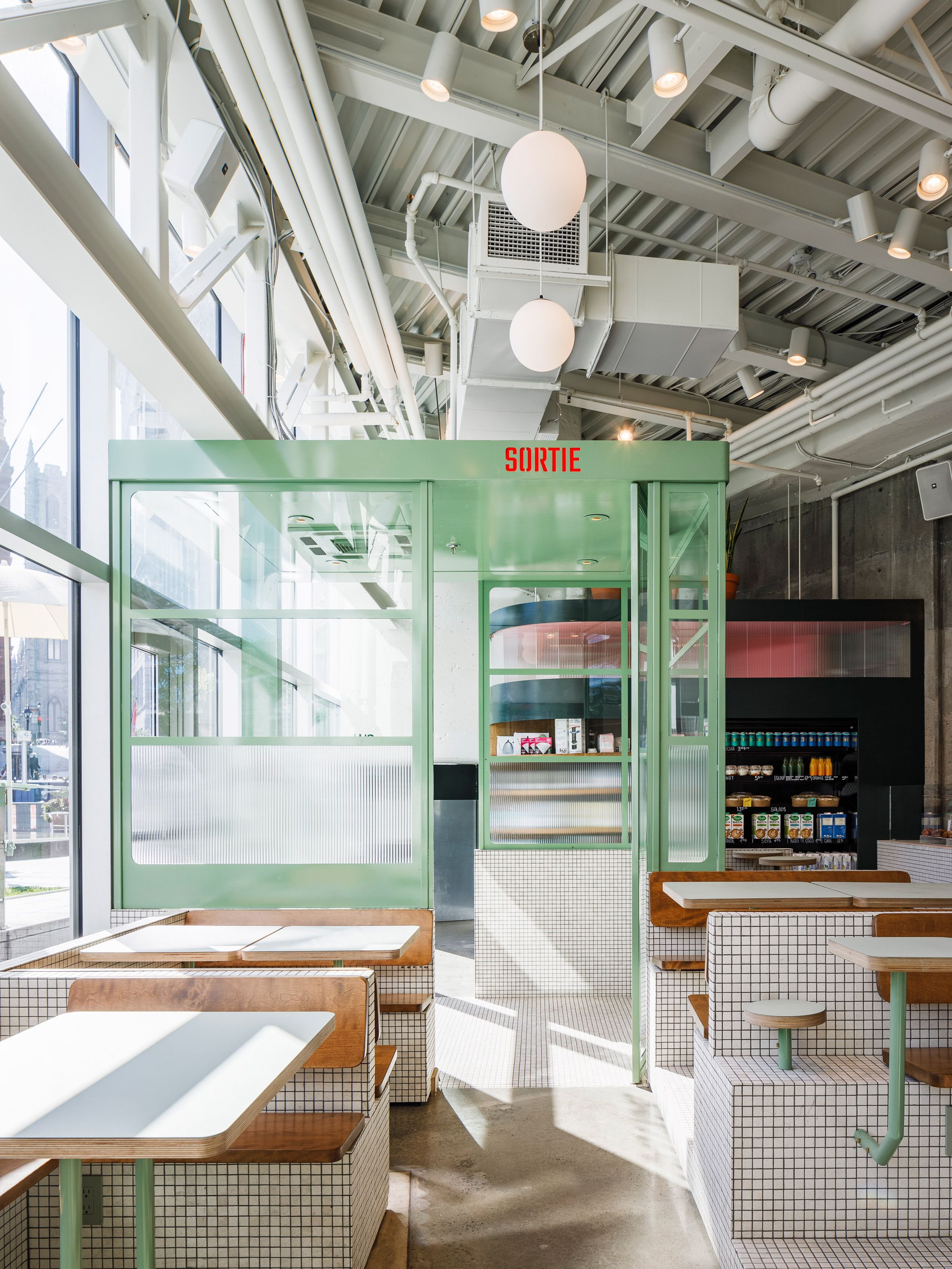 La Firme Transforms Cramped Space Into Montreal S Sun Lit Melk Cafe In 2020 Built In Furniture Industrial Coffee Shop Cafe Design