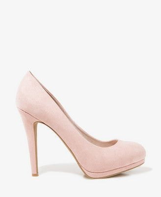 Faux suede pumps featuring a tonal platform. Padded insole. Round toe. Textured outsole.