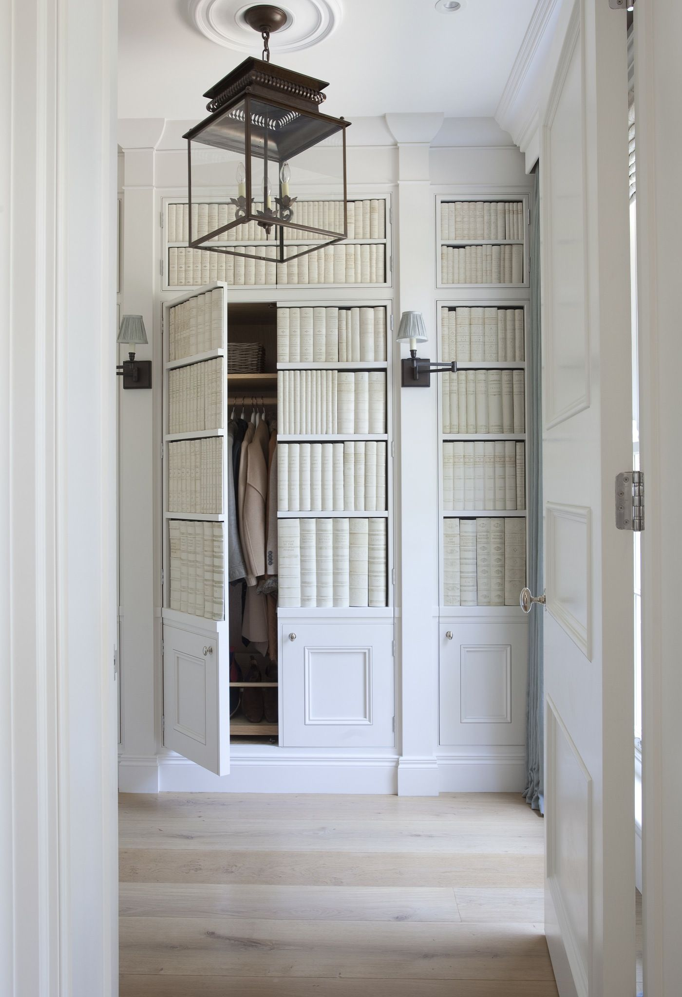 Concealed storage and coat closet space from this coastal style room
