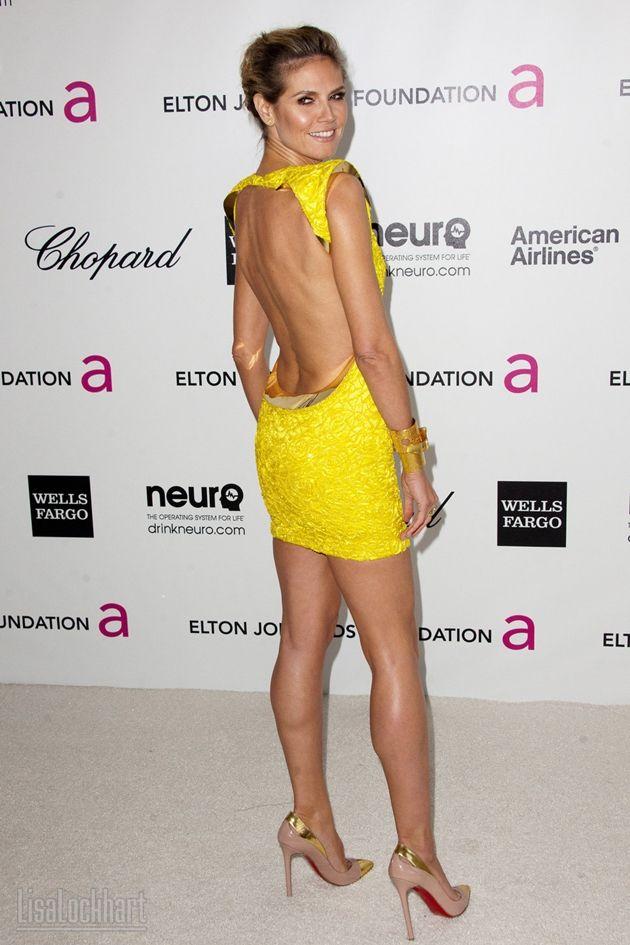 Heidi Klum in a Paule Ka dress & Christian Louboutin shoes.