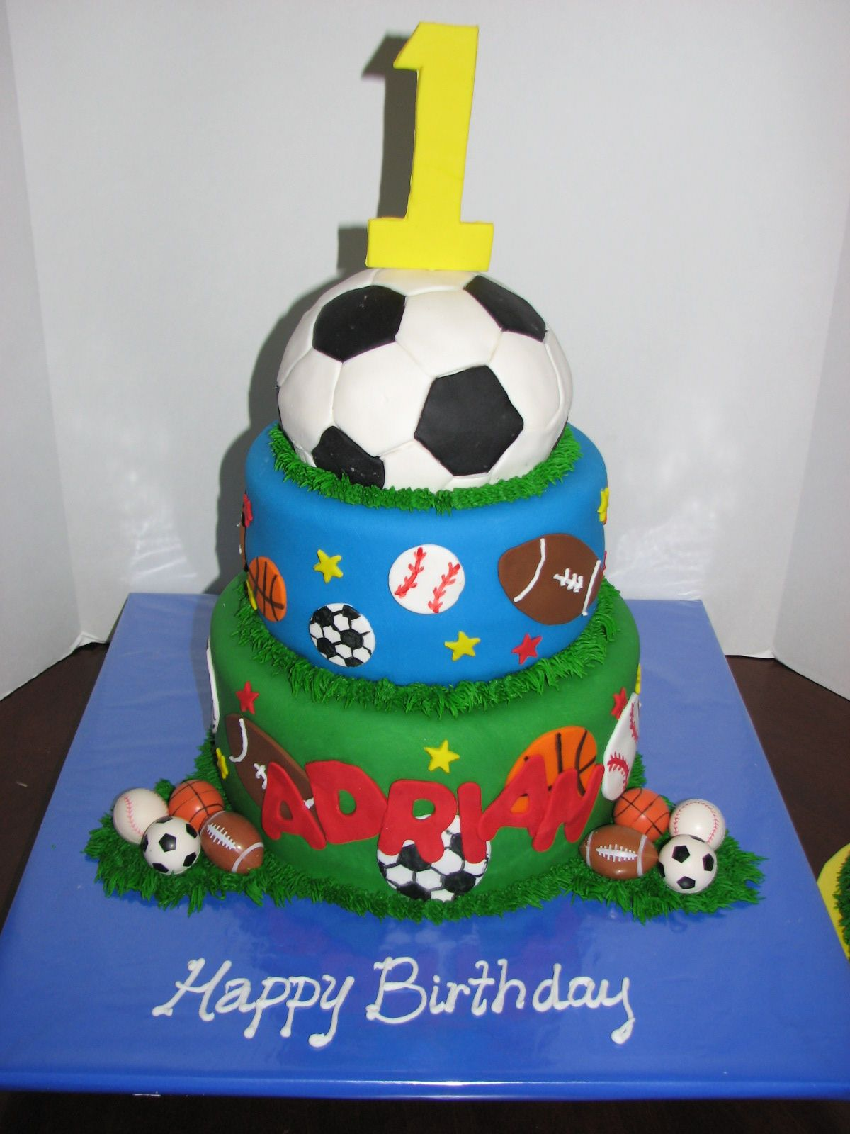 Sports cake but with a basketball on top minus the 1 on top
