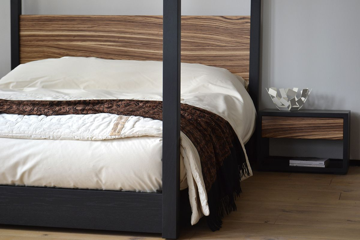 the cube four poster and bedside table in black lacquered oak and