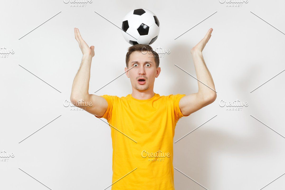 Inspired Young Fun European Man Fan Or Player In Yellow Uniform Hold On Head Soccer Ball Cheer Favorite Football Team Isolated On White Background Sport Pla Head Soccer Soccer Ball European