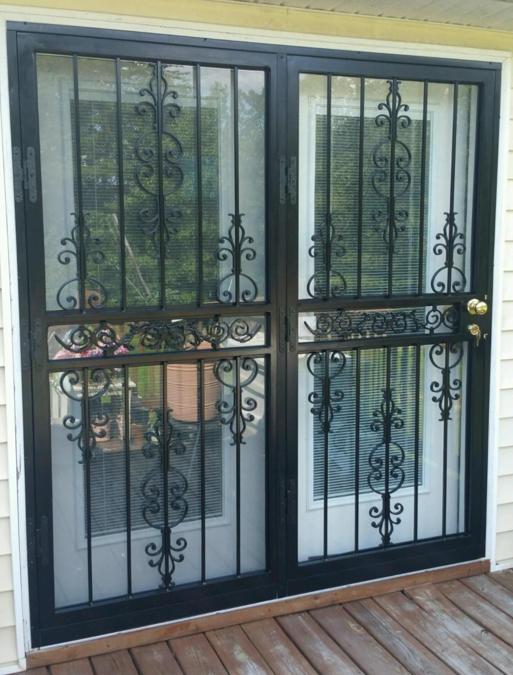 73x80 model 547 spanish scroll high security patio door installed