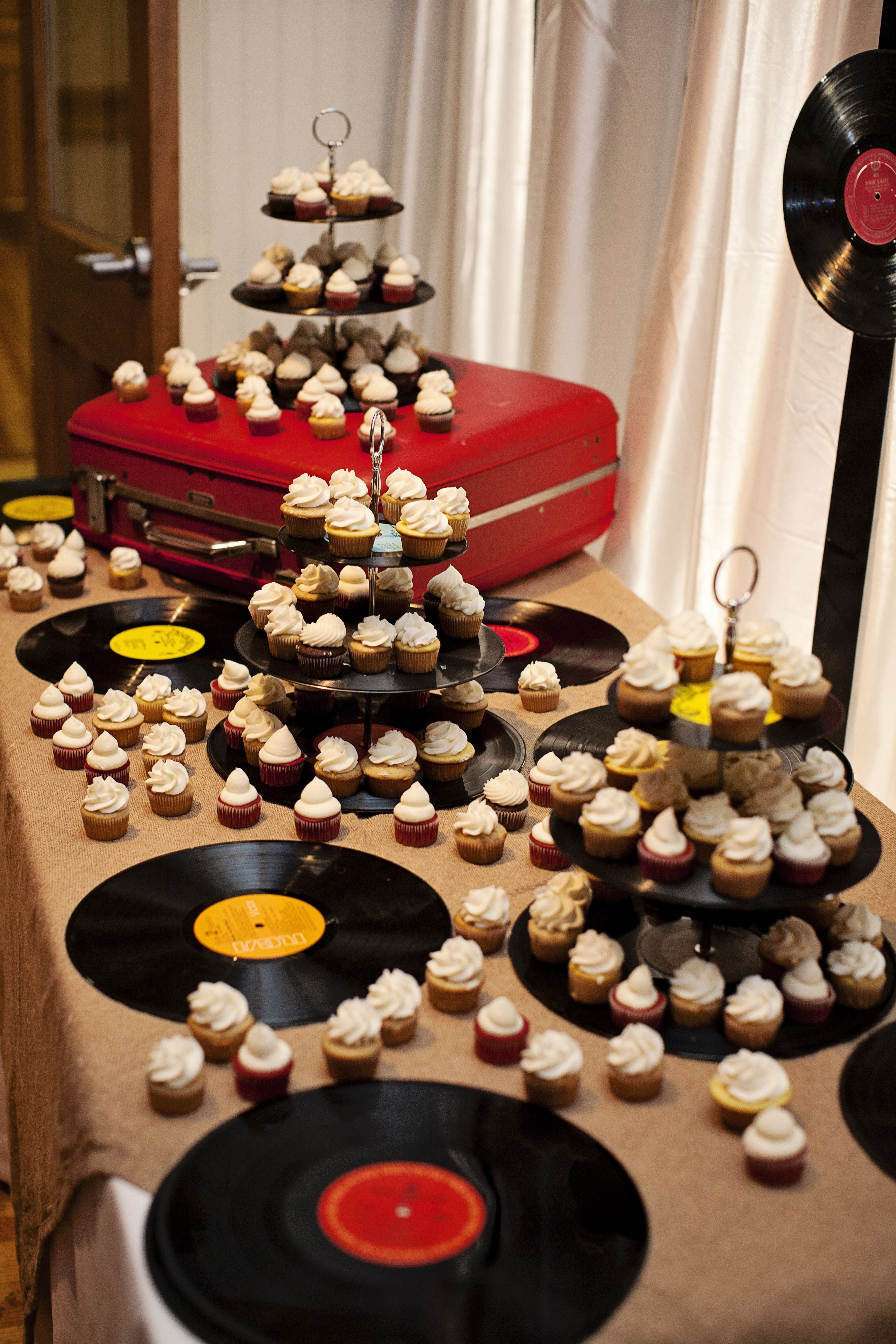 Cupcake grooms cake with record cake stands. Baby shower