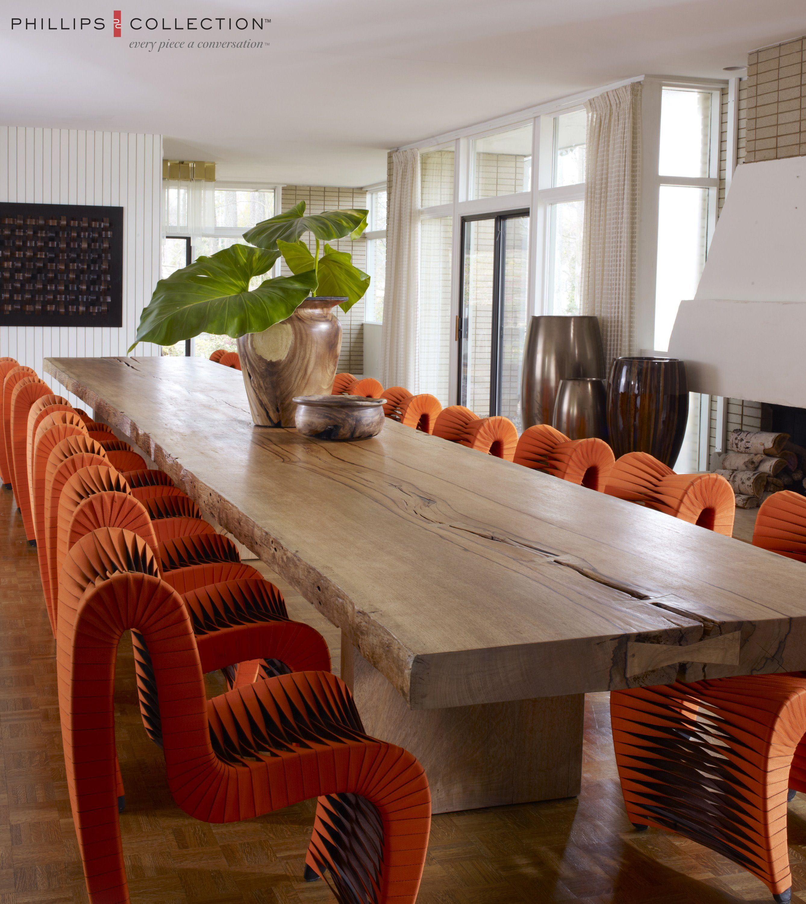 Se Rosse Calligaris e of a kind dining table and orange seat belt chairs