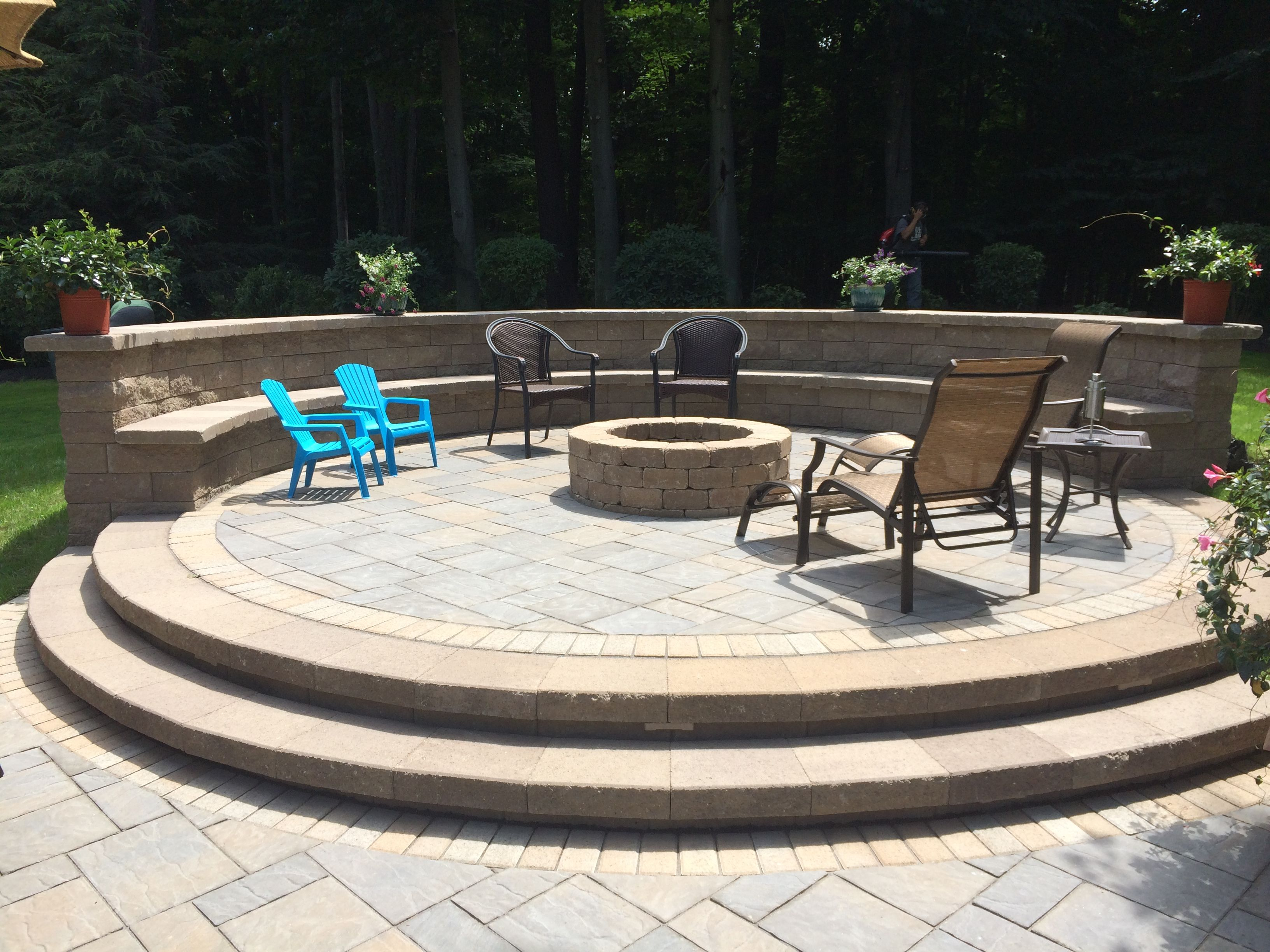 paver patio with gas fire pit and sitting wall with backrest