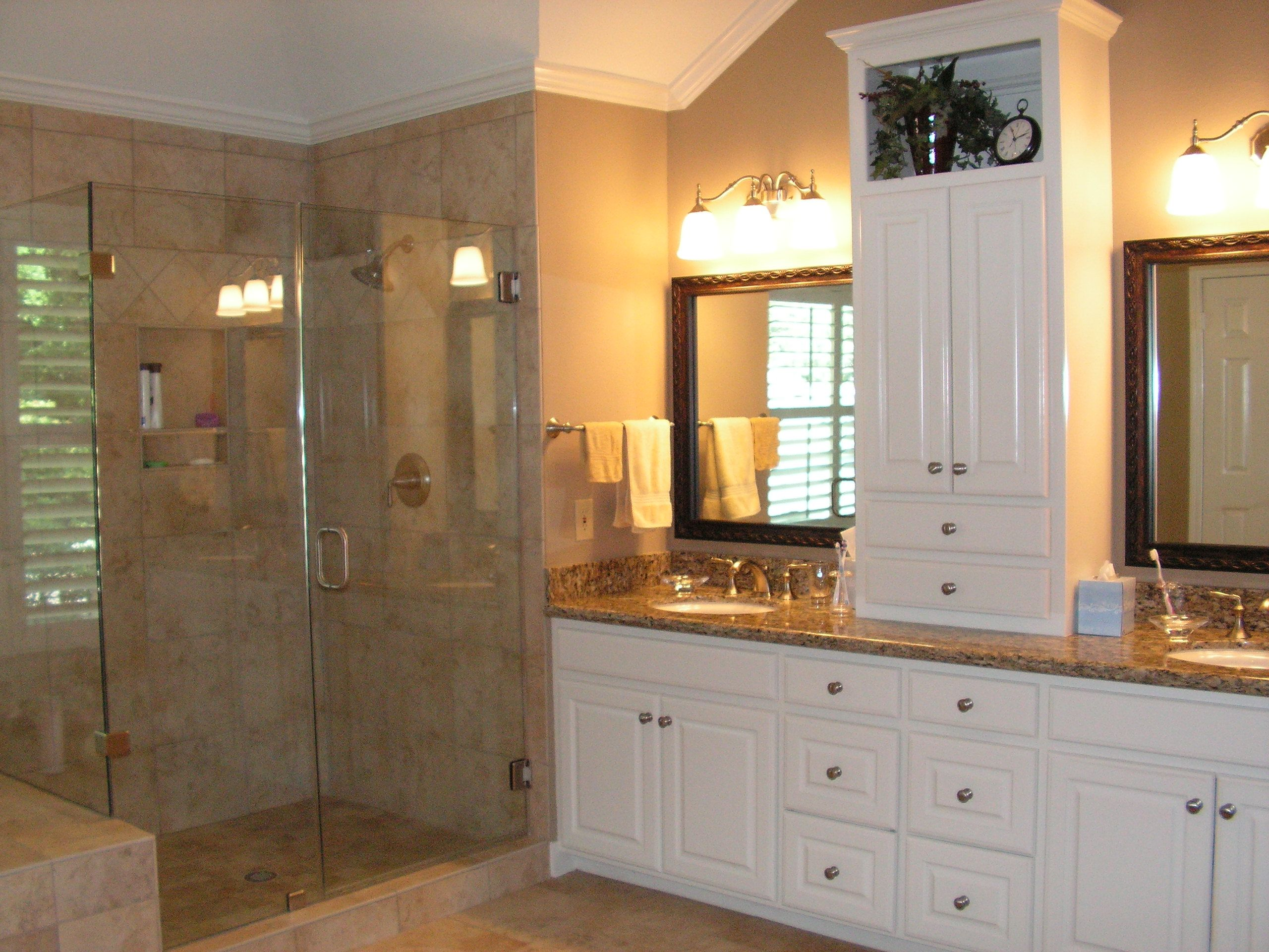 Bathroom remodel showing new heavy frameless shower enclosure and two shelf recessed shower cad