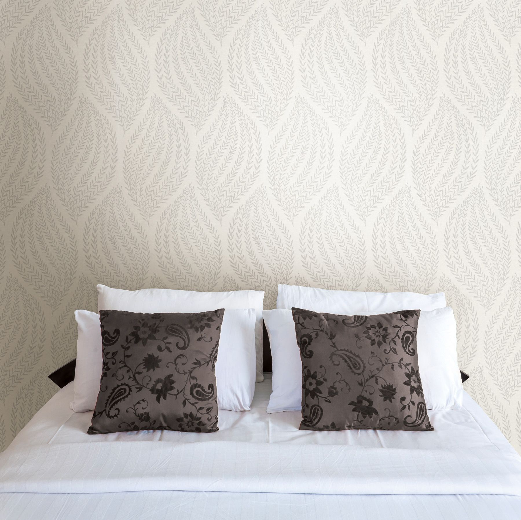a romantic bedroom decor idea with a wallpaper feature wall