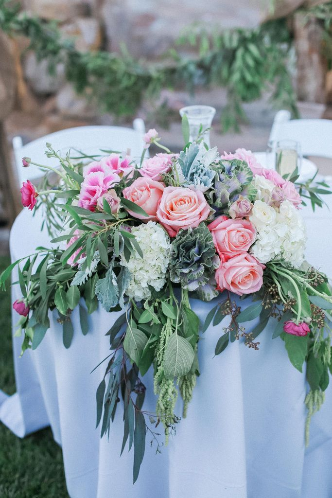 The Couple S Sweetheart Table Was Adorned With A Lush