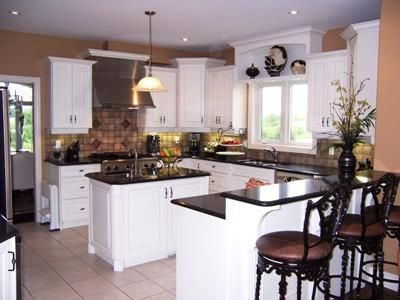 Antique White Cabinets Black Appliances different heights but same on bottom antique-white-kitchen