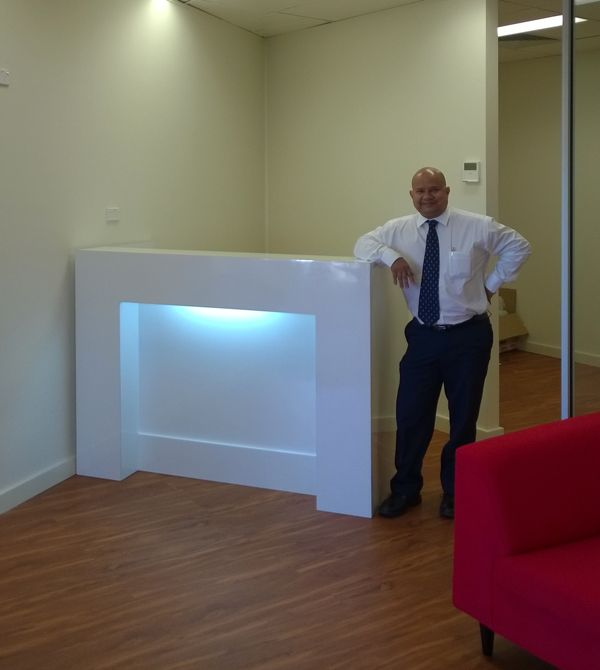 New reception desk This new reception desk for think smart real estate is a customized Wembley. Because of the angled wall and the office partitioning we shortend the counter to 1600mm from our standard 1800mm to allow  for a decent walk through. The white desk on the timber floor gives a