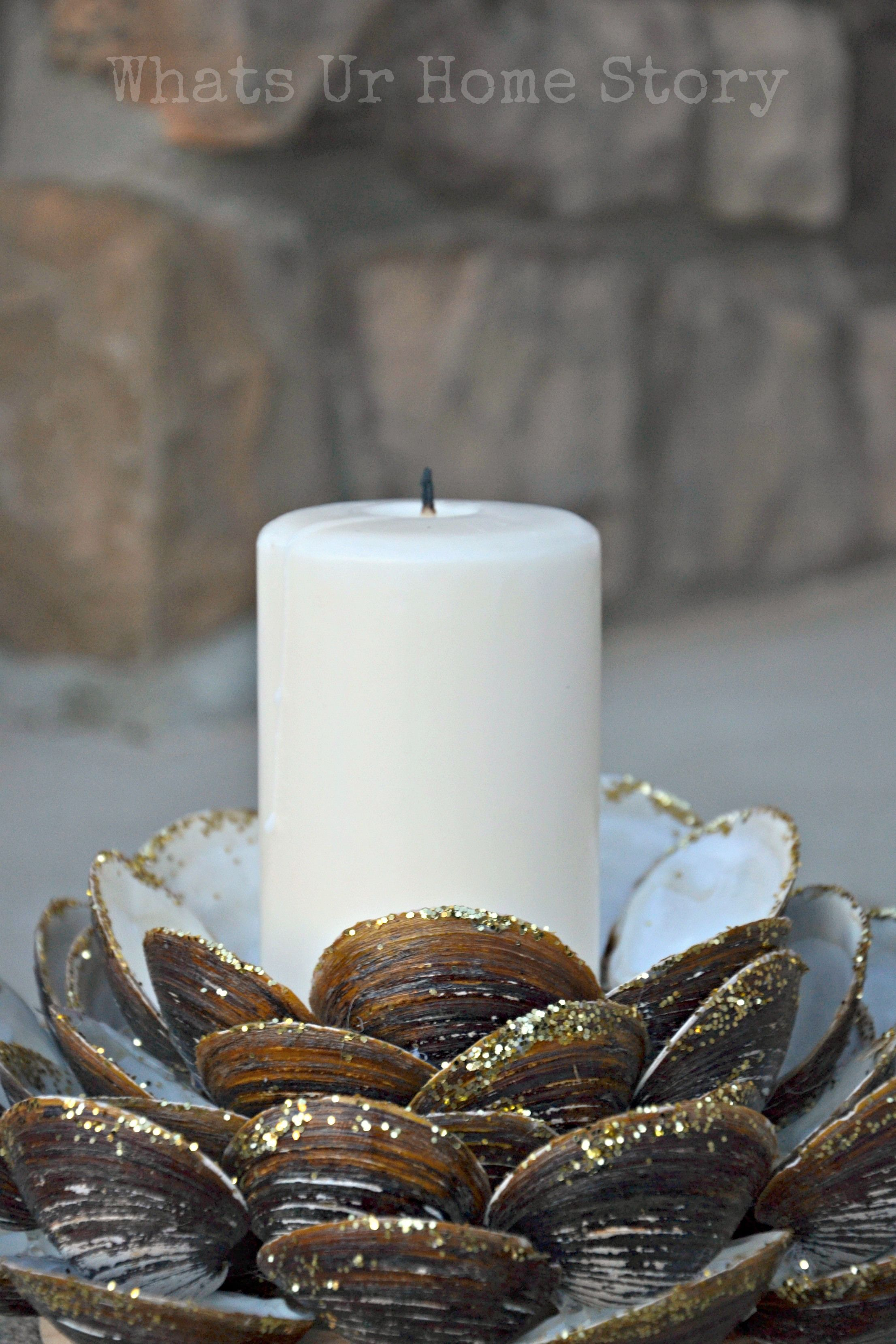 Seashore lovers, take note: A teensy bit of glitter on the edge of shells adds just enough pop to an otherwise muted seashell centerpiece.