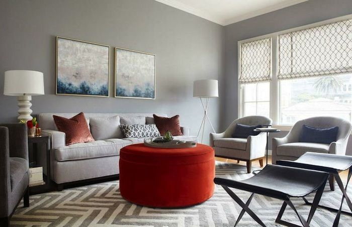 Neutral Living Room With Bright Ottoman Accent.