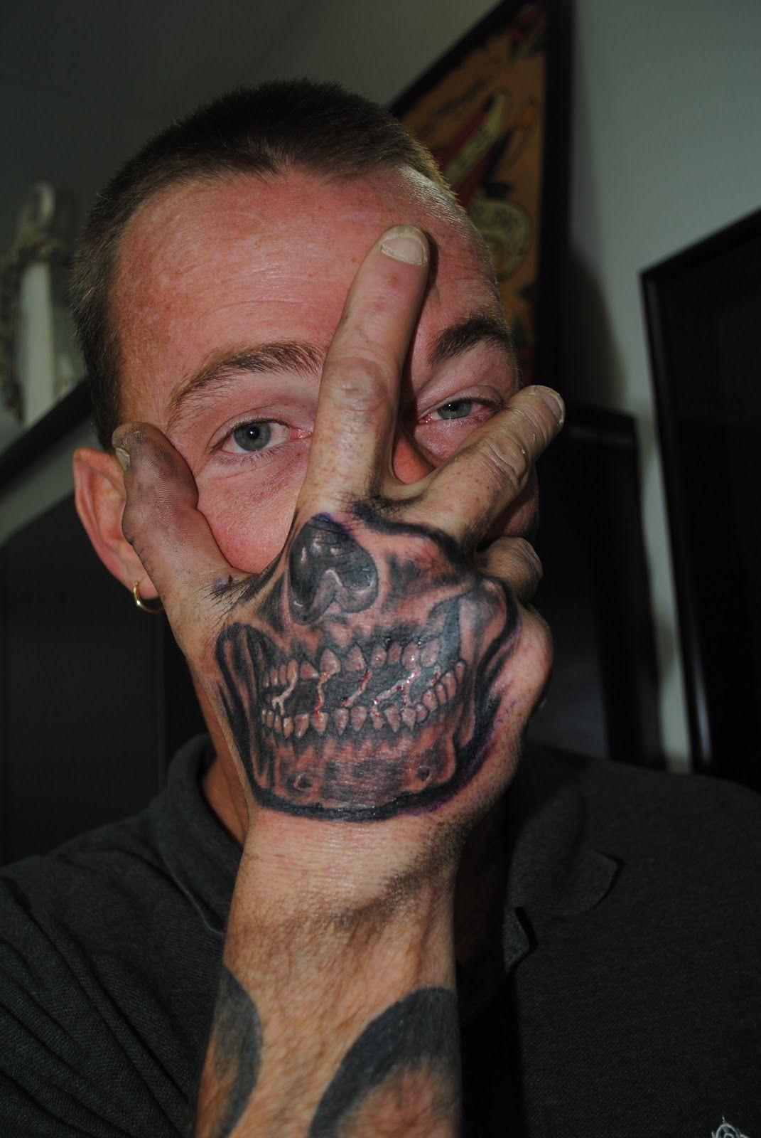 Skull Face Hand Tattoo. This guy was a nut. Skull hand