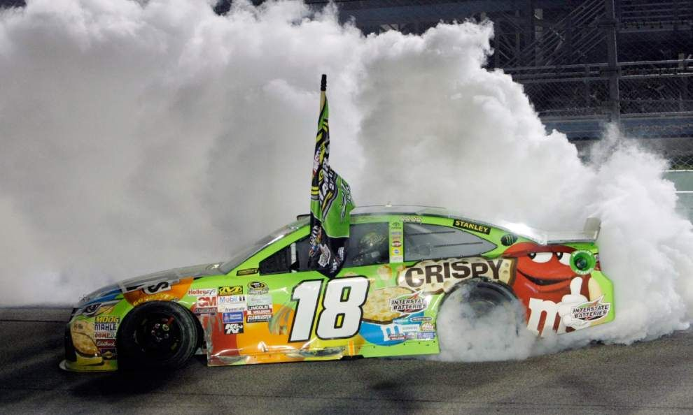 kyle busch does a burnout after winning the nascar sprint cup