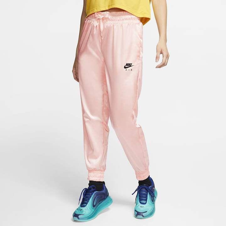 Photo of Nike Air Women's Satin Track Pants. Nike.com