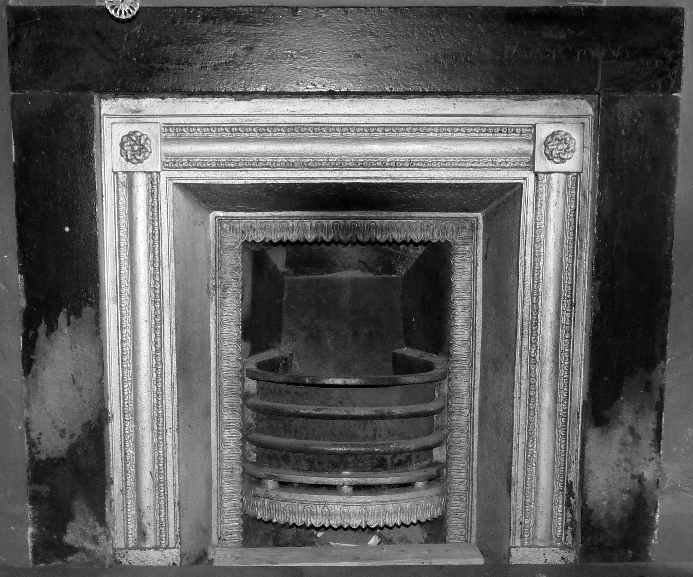 cast iron fireplace in the bedroom painted silver sometime in the
