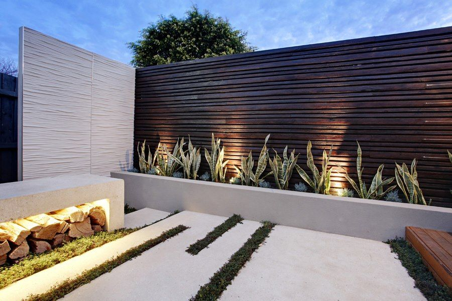 Compact garden design project under the australian sun for Modern exterior wall design