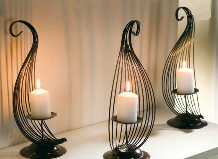 Artesanias en hierro forjado camas candelabros muebles for Decoracion para pared en hierro