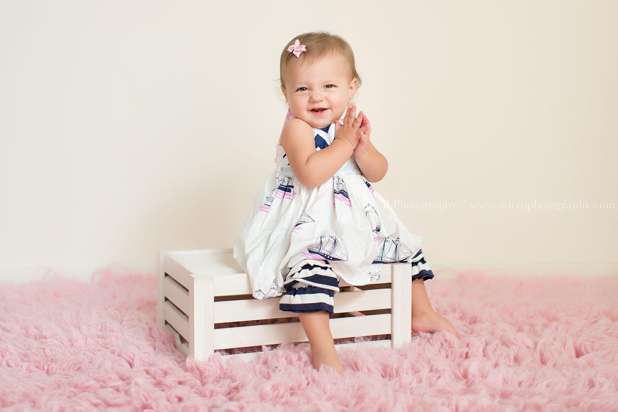 little girl one year old baby girl studio