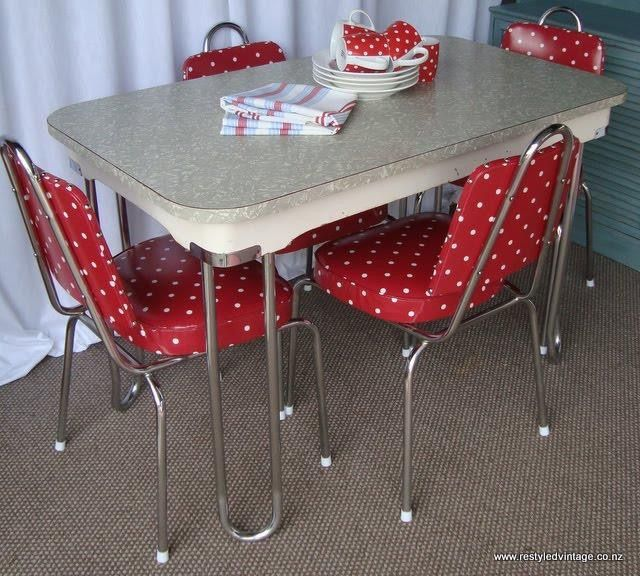 Chrome dinette with grey cracked ice tabletop red chairs with